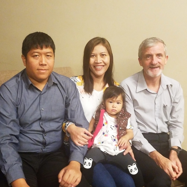 Doi, Yao and their daughter, and Charles Harvey (Co-Director of Grace Ministries)