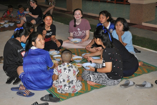 WCHS students sharing a meal in Thailand